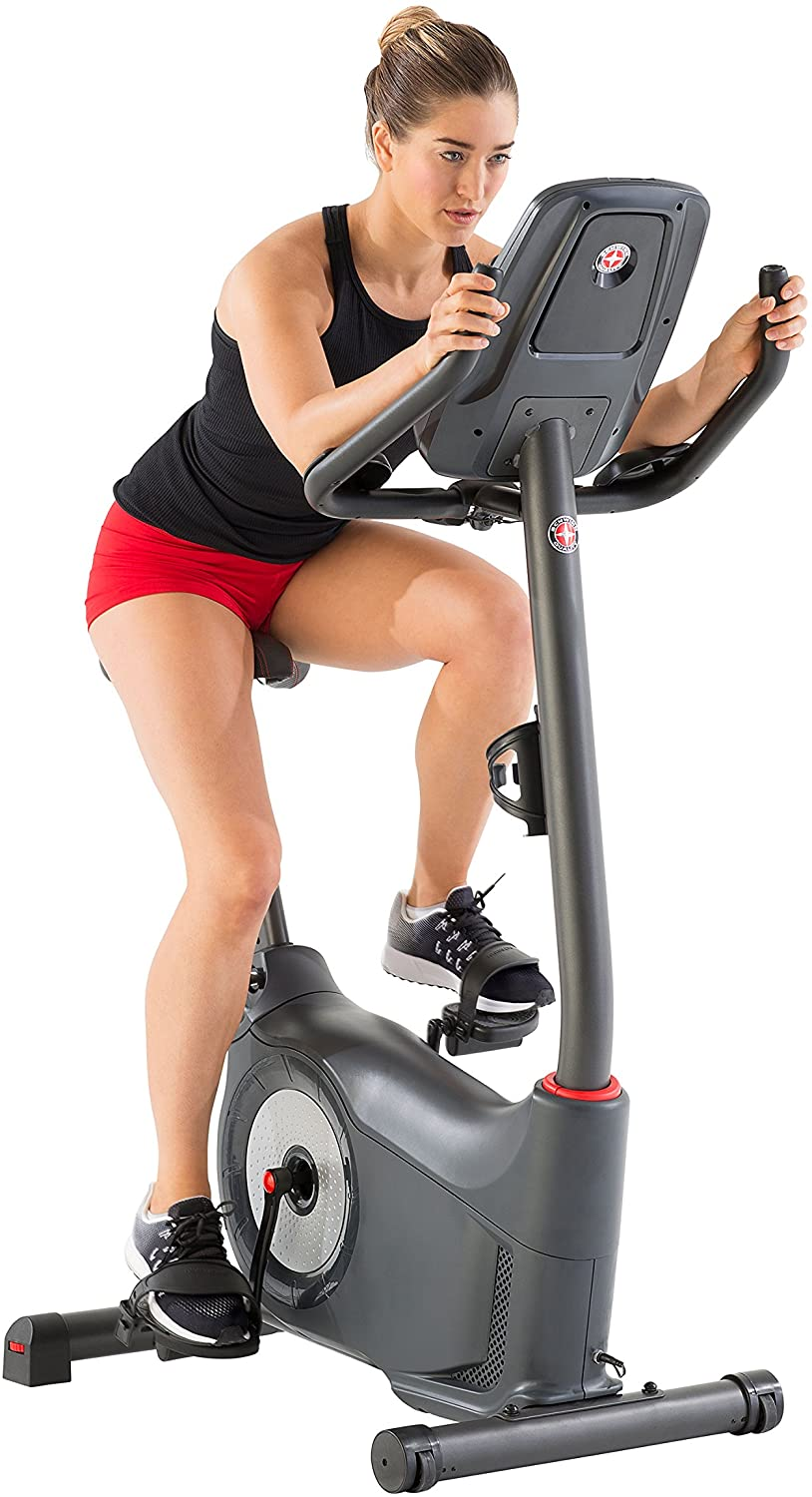 This woman is riding Best Upright Exercise Bike